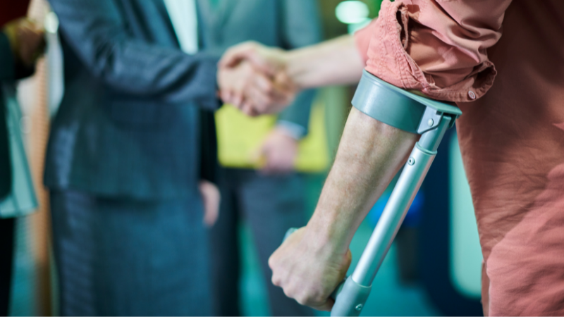 client shaking hand with personal injury solicitor