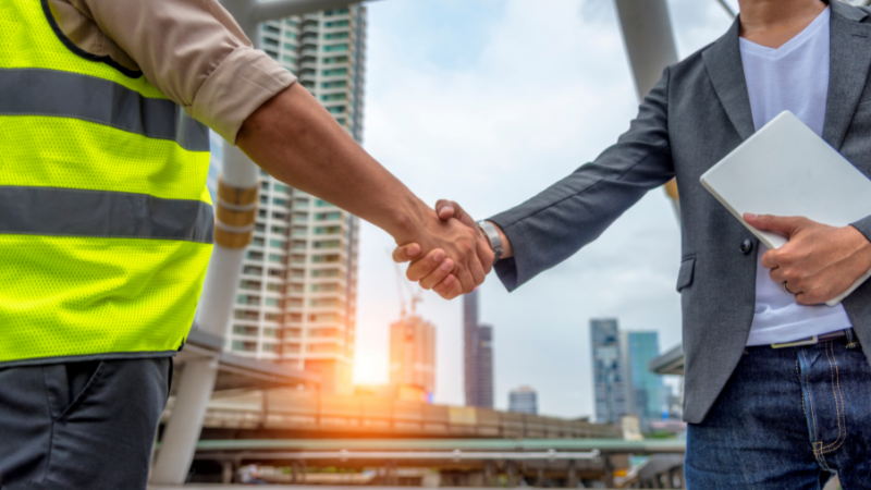Construction Law Solicitor shaking hand with client