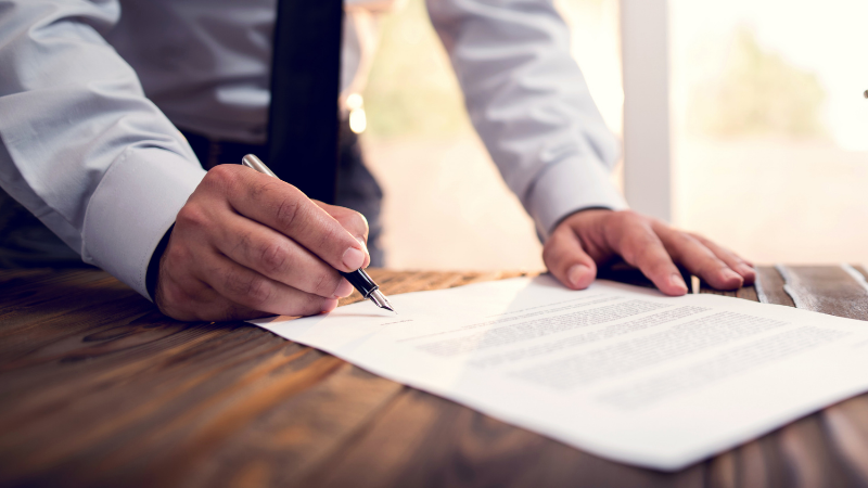 Contentious Probate solicitor signing paper