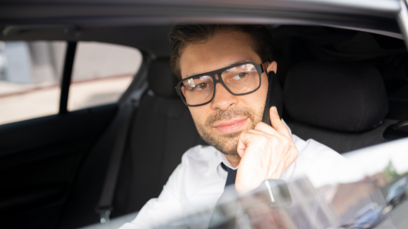 man in car on mobile phone